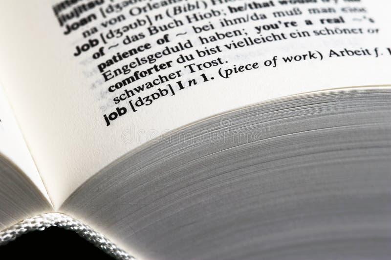 Trabajo en diccionario fotografía de archivo libre de regalías