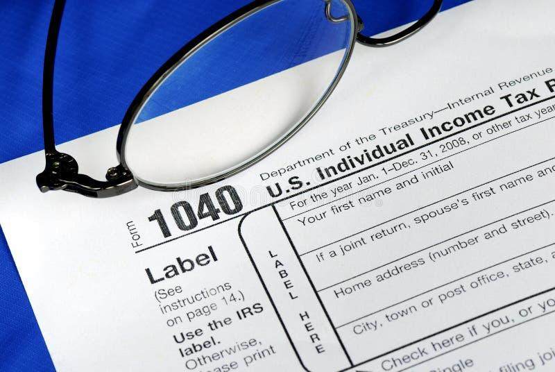 Trabajo en el impuesto sobre la renta de Estados Unidos 1040 imagen de archivo