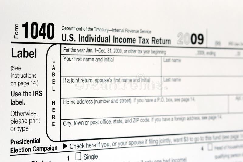 Trabajo en el impuesto sobre la renta de Estados Unidos 1040 imagen de archivo libre de regalías