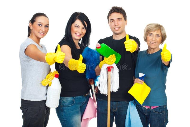 Trabajo en equipo acertado de la gente de la limpieza imagenes de archivo