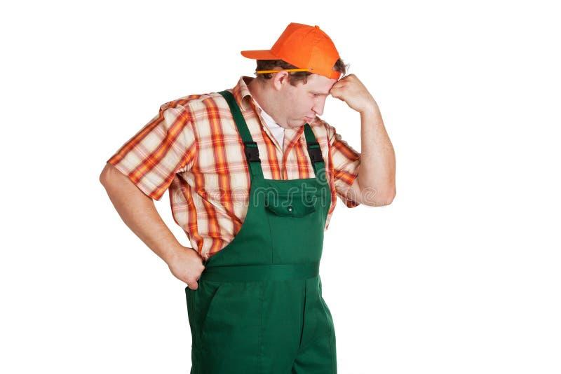 Trabajo en una gorra de béisbol al revés imagen de archivo