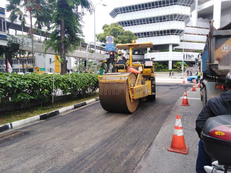 Trabajos de construcción de carreteras en Singapur fotos de archivo