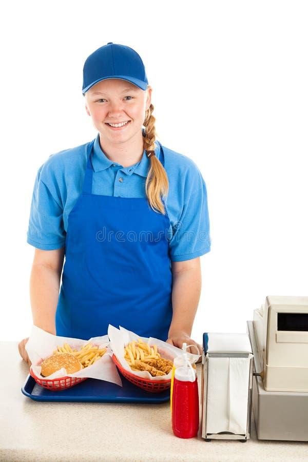 Trabalhador adolescente amigável no restaurante fotografia de stock