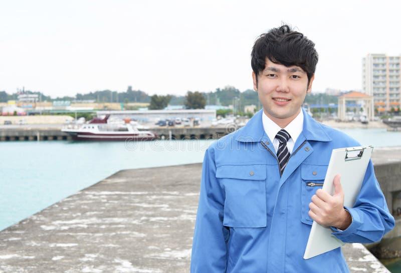 Trabalhador asiático de sorriso fotos de stock royalty free
