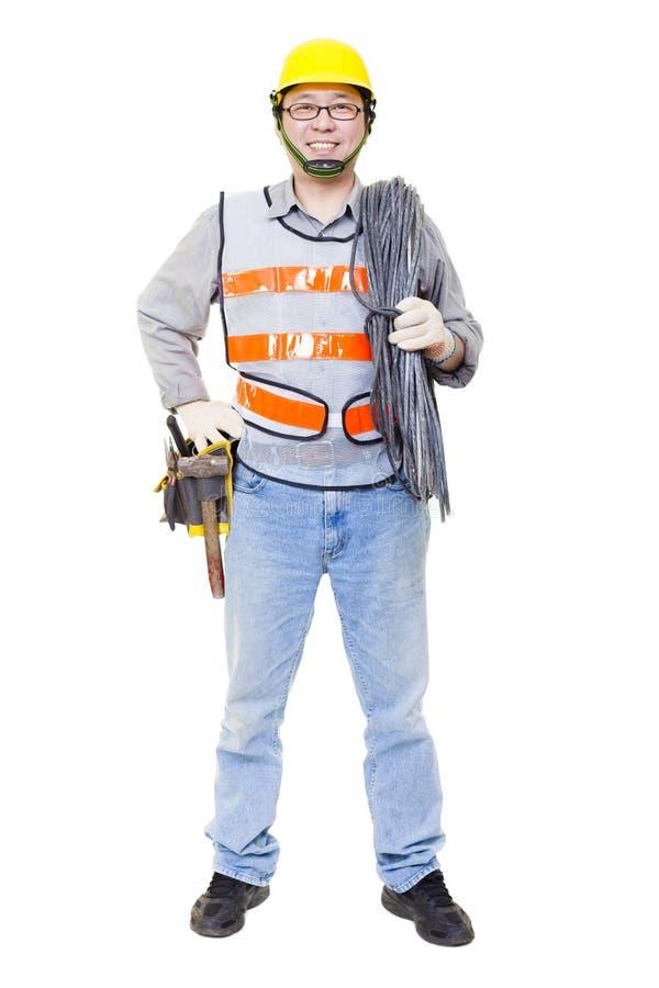 trabalhador com cabo bonde e capacete imagem de stock royalty free