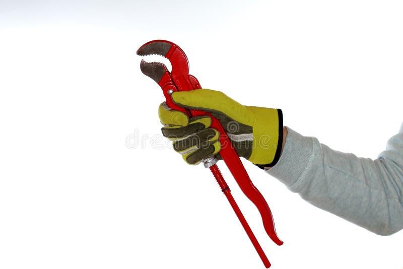 Trabalhador com luvas e chave foto de stock royalty free