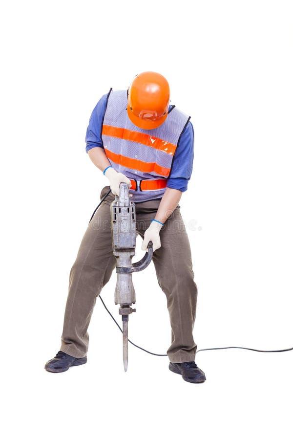 Trabalhador com o equipamento da broca de martelo pneumático isolado fotografia de stock