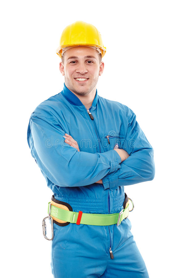 Trabalhador considerável novo com os braços dobrados imagens de stock royalty free