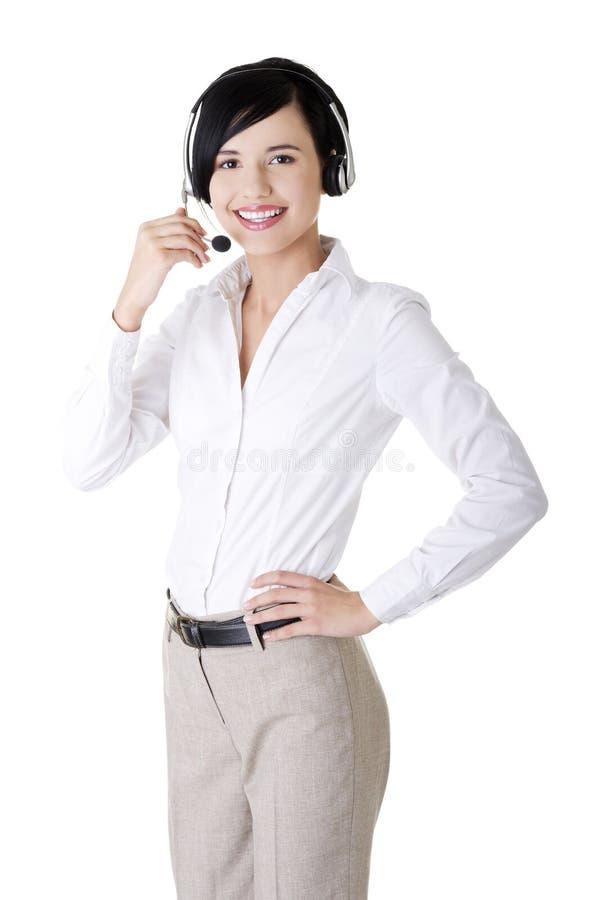 Download Trabalhador Consideravelmente Novo Do Centro De Chamadas Que Desgasta Uns Auriculares Imagem de Stock - Imagem de atendimento, adulto: 26516057