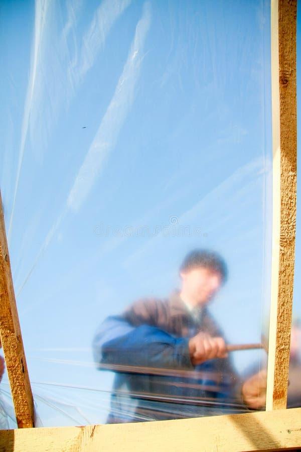 Download Trabalhador da construção foto de stock. Imagem de hothouse - 12809262