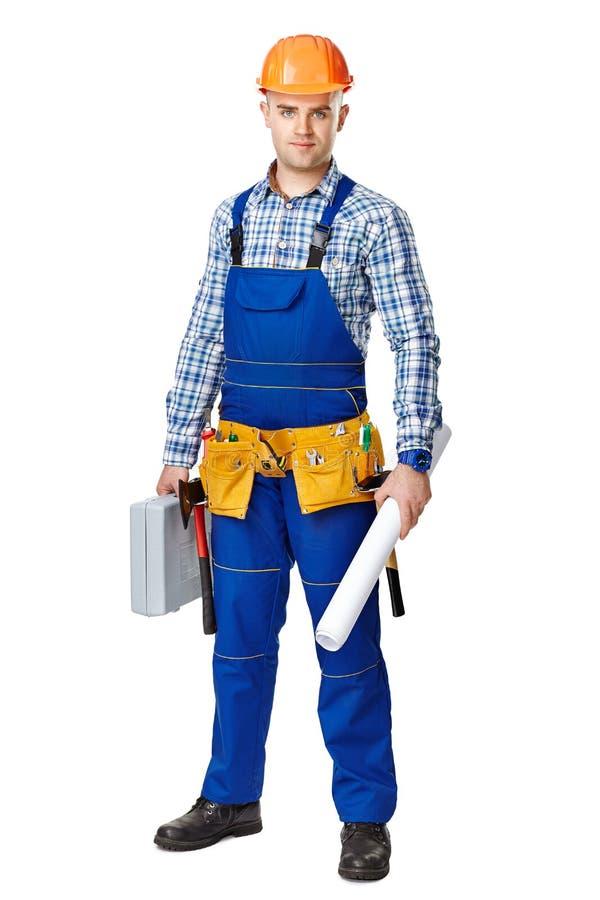 Trabalhador da construção com caixa de ferramentas e desenhos foto de stock