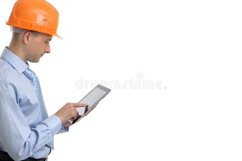 Trabalhador da construção com tabuleta digital foto de stock