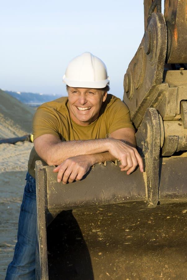 Trabalhador da construção de sorriso feliz. imagem de stock royalty free