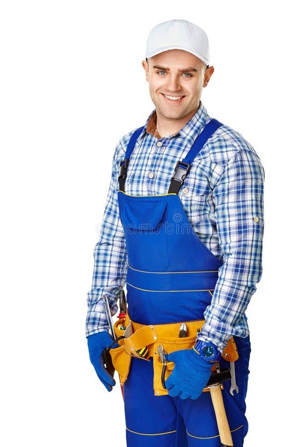 Trabalhador da construção masculino novo feliz fotografia de stock royalty free