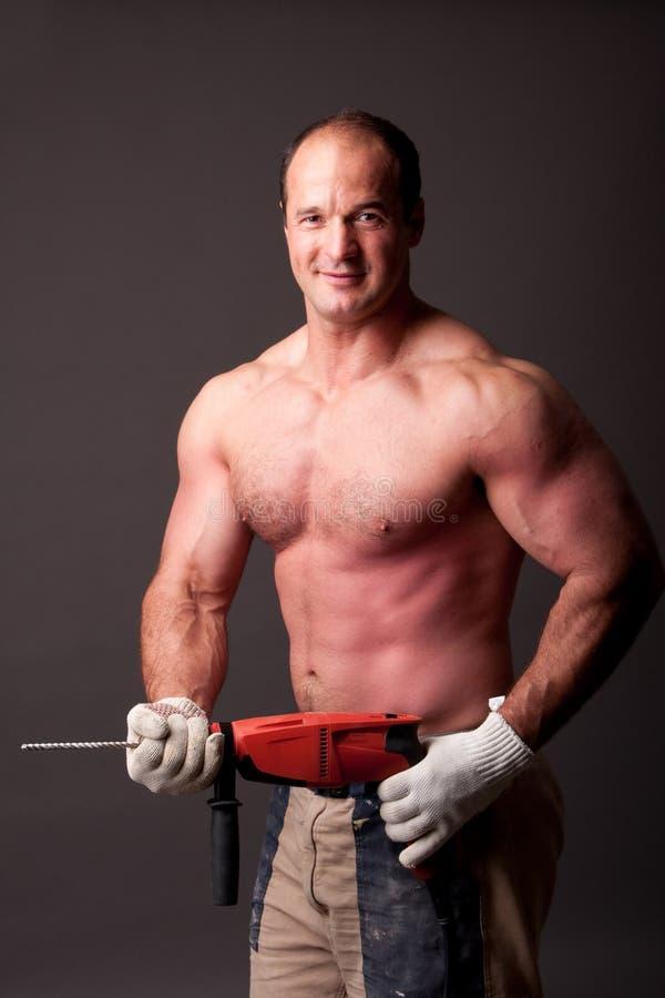Trabalhador da construção muscular fotos de stock