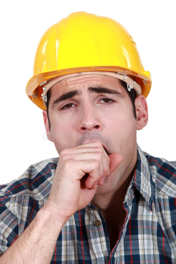 Trabalhador da construção que boceja imagens de stock