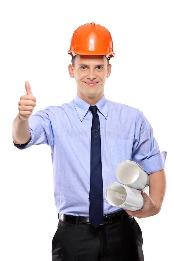 Trabalhador da construção que dá o thumbs-up imagem de stock