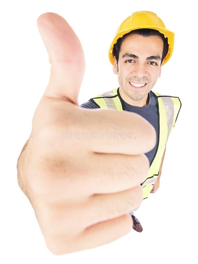 Trabalhador da construção que dá os polegares acima fotografia de stock