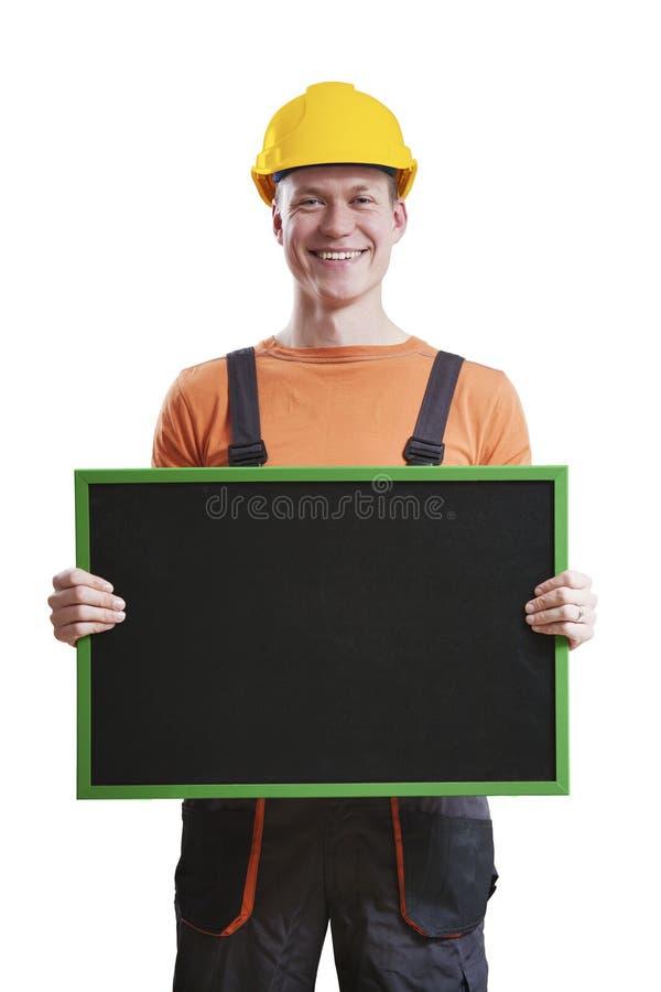 Trabalhador da construção que guarda o quadro imagem de stock royalty free