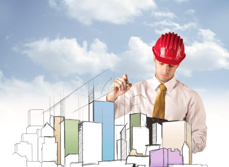 Trabalhador da construção que planeia uma vista da cidade foto de stock