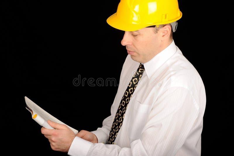 Trabalhador da leitura fotos de stock royalty free