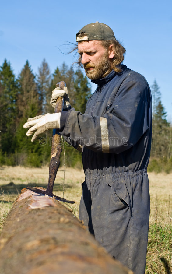 Trabalhador da madeira serrada imagens de stock royalty free