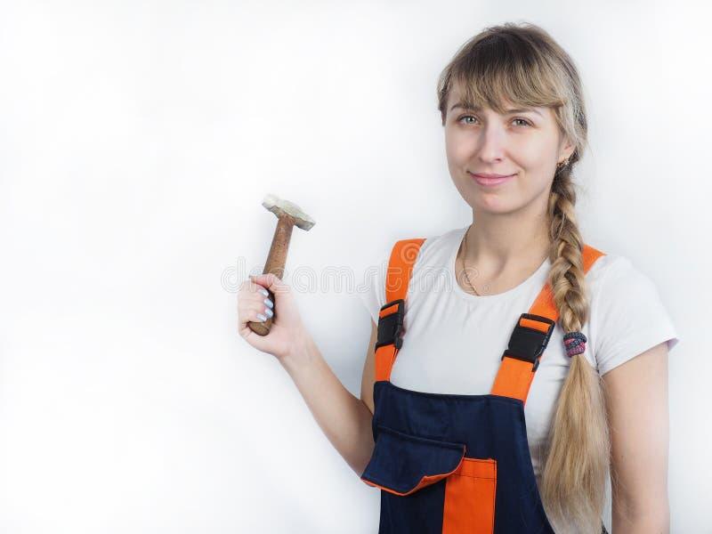 Trabalhador da menina com a ferramenta imagem de stock royalty free