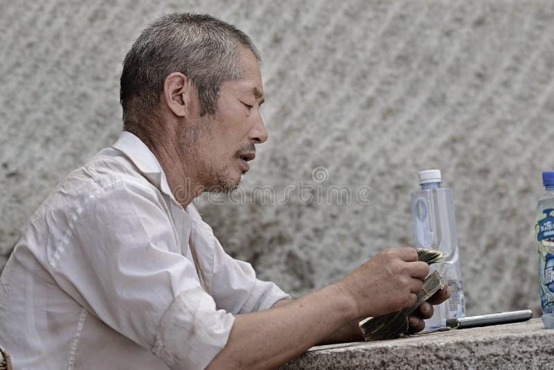 Trabalhador de Hua China-Harvest da montagem foto de stock