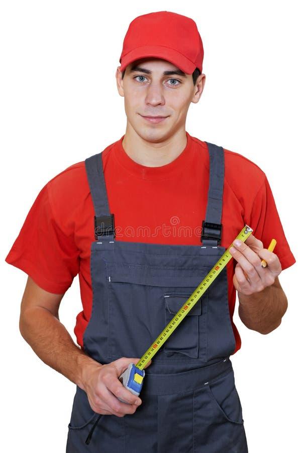 Trabalhador do trabalhador manual com fita de medição fotografia de stock royalty free