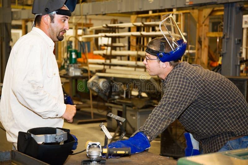 Trabalhador e supervisor do metal foto de stock royalty free