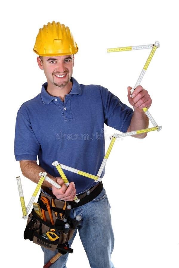 Trabalhador ereto de sorriso isolado dos jovens imagem de stock