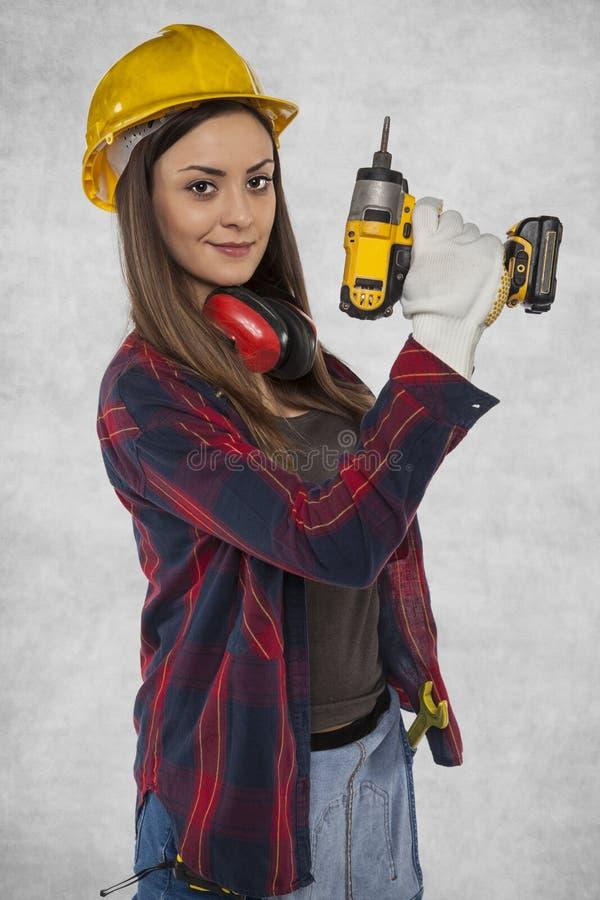 Trabalhador fêmea, trabalhador manual em casa fotografia de stock