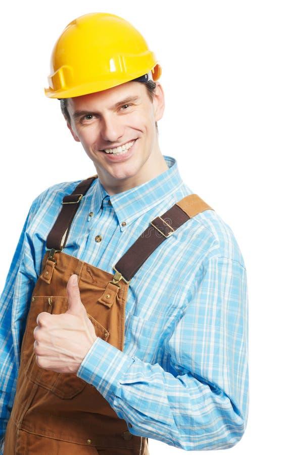 Trabalhador feliz no capacete de segurança e globalmente com polegar acima foto de stock royalty free