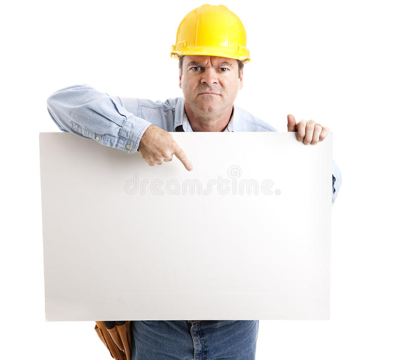 Trabalhador irritado com sinal foto de stock