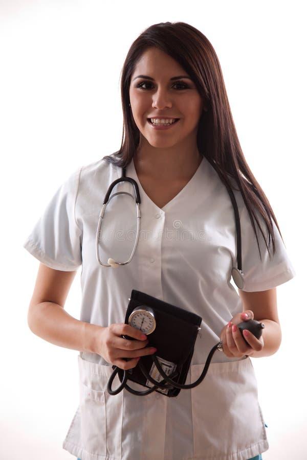 Trabalhador latino-americano bonito dos cuidados médicos dos anos 20 imagem de stock