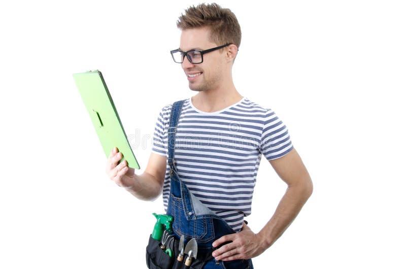 Trabalhador manual atrativo com a tabuleta Alegria e felicidade imagem de stock