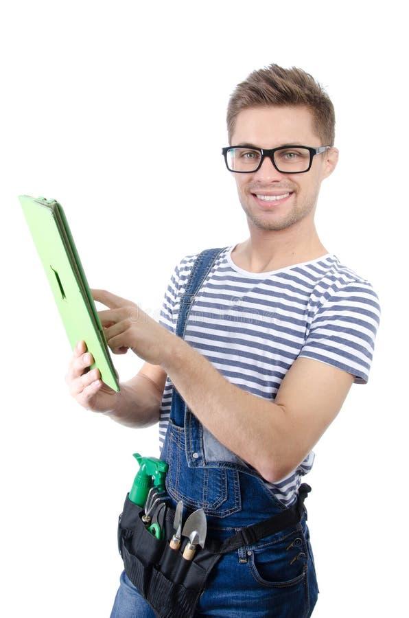 Trabalhador manual atrativo com a tabuleta Alegria e felicidade fotografia de stock royalty free