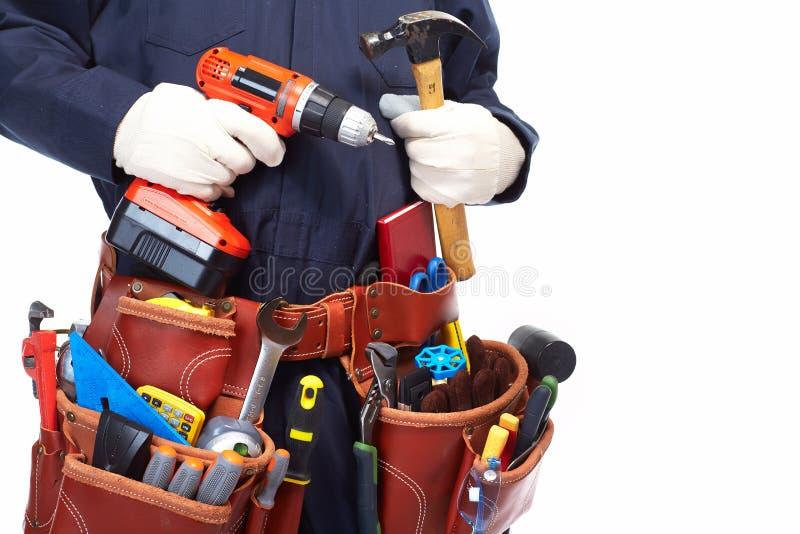Trabalhador manual com uma correia da ferramenta. fotografia de stock royalty free