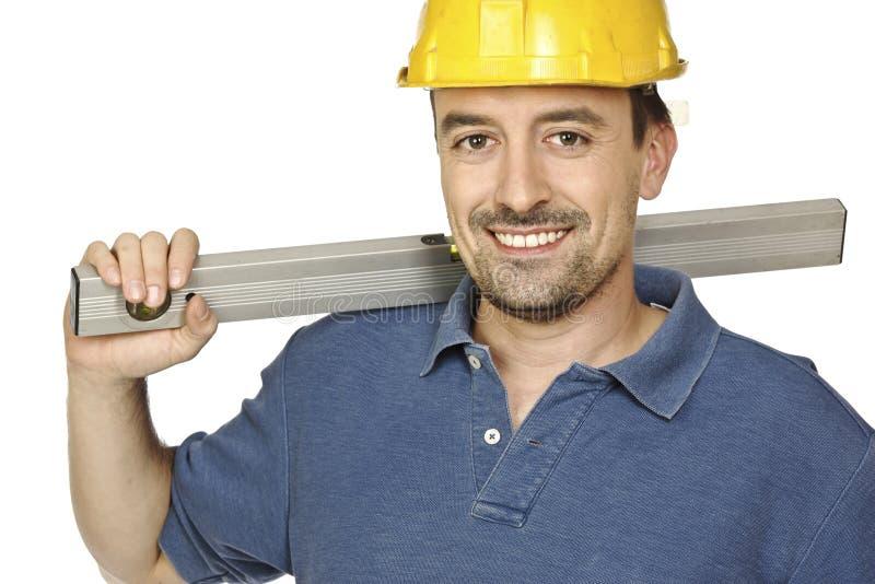 Trabalhador manual confiável com nível de espírito imagem de stock royalty free