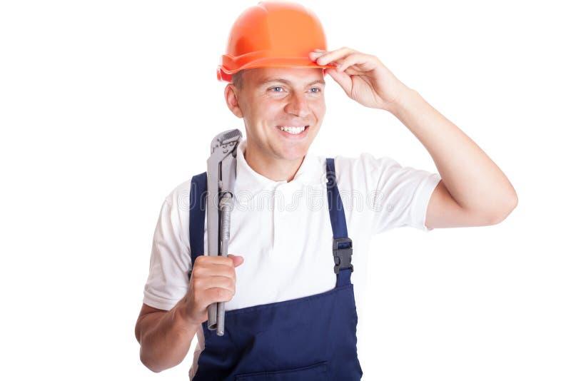 Trabalhador manual considerável de sorriso fotografia de stock