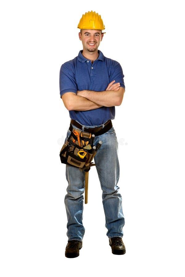 Trabalhador manual novo isolado estando fotos de stock
