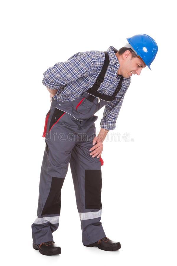 Trabalhador masculino que sofre da dor imagens de stock