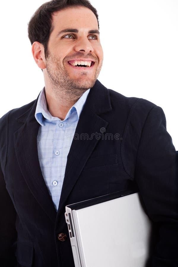 Trabalhador novo que carreg um portátil imagens de stock