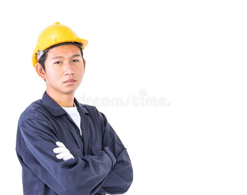 Trabalhador novo que está com o braço cruzado foto de stock royalty free