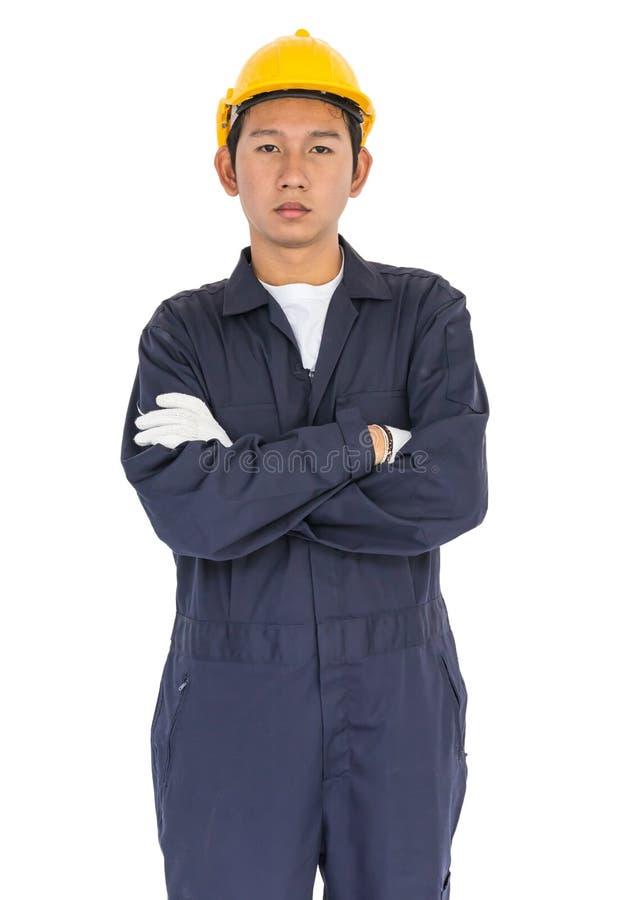 Trabalhador novo que está com o braço cruzado imagens de stock