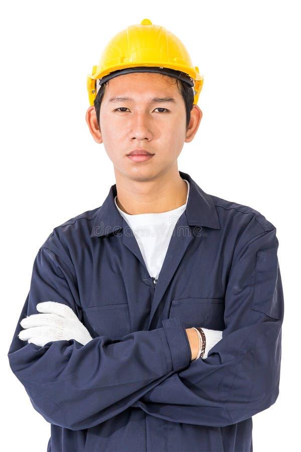 Trabalhador novo que está com o braço cruzado imagens de stock royalty free