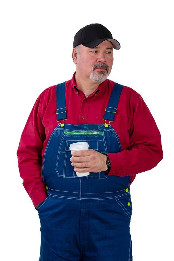 Trabalhador ou fazendeiro pensativo que olham ao lado imagem de stock royalty free