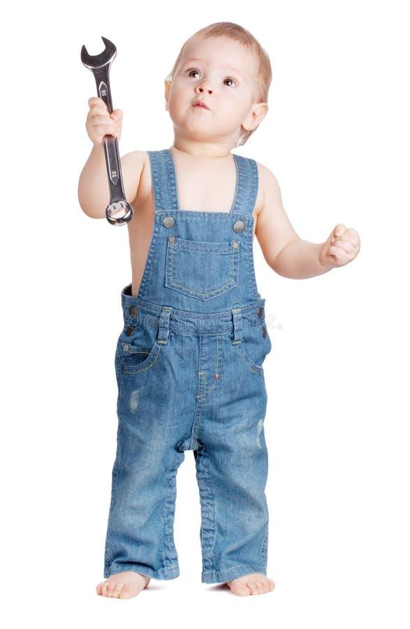 Trabalhador pequeno do bebê com chave de chave inglesa fotografia de stock