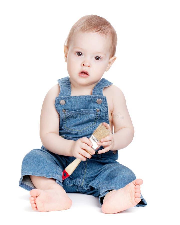 Trabalhador pequeno do bebê com escova de pintura foto de stock royalty free