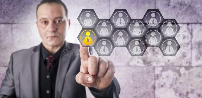 Trabalhador prático de Selecting One Male do gerente da hora fotografia de stock royalty free